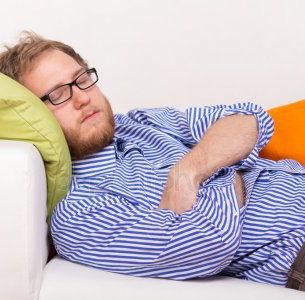 depositphotos_71916635-stock-photo-young-man-sleeping-on-couch.jpg